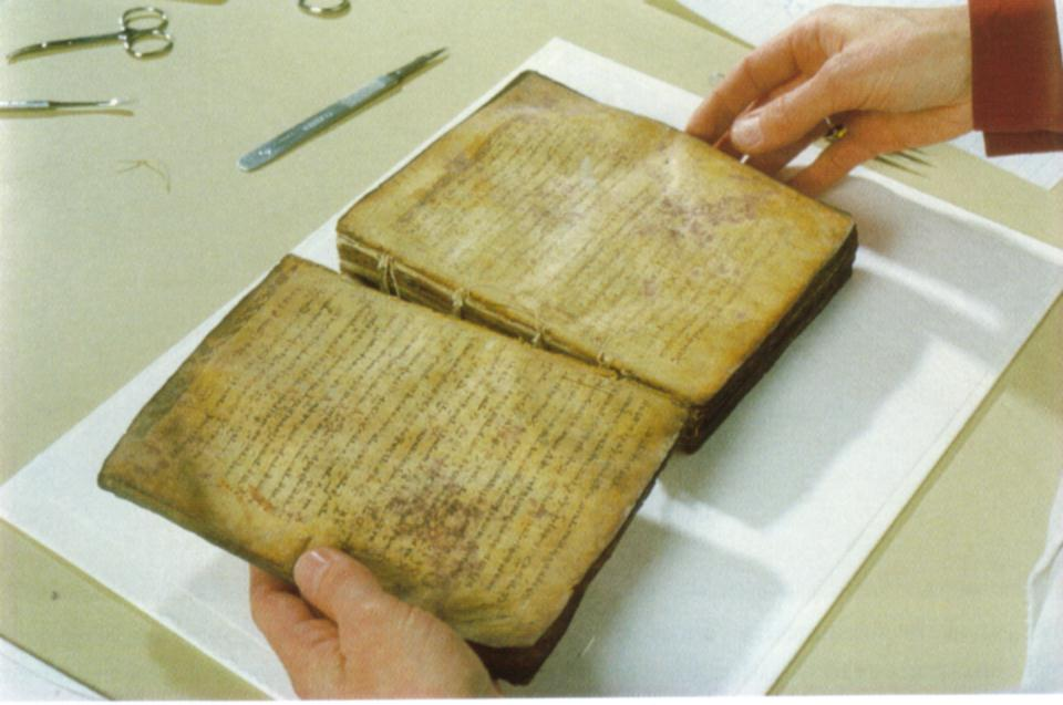 Separating the pages of the Archimedes Codex.